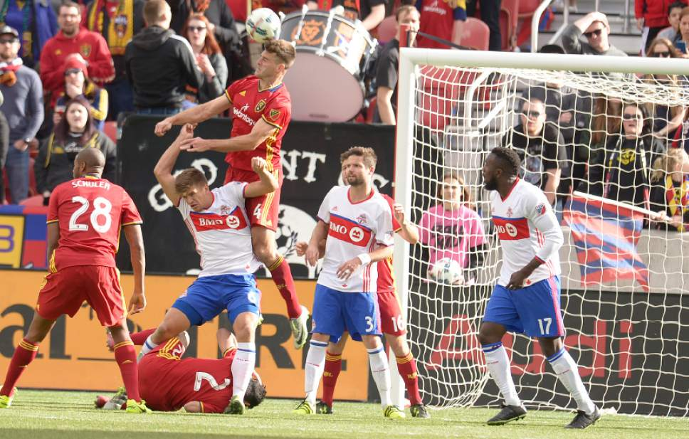 Leah Hogsten  |  The Salt Lake Tribune Real Salt Lake defender David Horst (4) heads out a kick at the net. Real Salt Lake tied the 2017 season home opener with Toronto FC, 0-0, Saturday, March 4, 2017 at Rio Tinto Stadium.