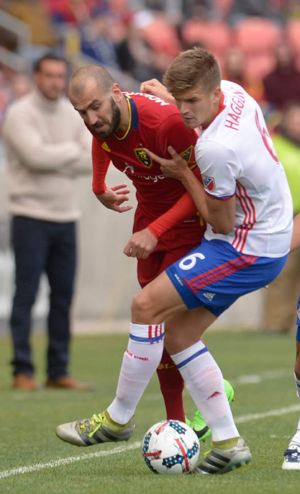 Leah Hogsten  |  The Salt Lake Tribune Toronto FC defender Nick Hagglund (6) holds Real Salt Lake forward Yura Movsisyan (14) at the line. Real Salt Lake kicked off the 2017 season Saturday, March 4, 2017 with a home opener against Toronto FC at Rio Tinto Stadium. Real Salt Lake and Toronto FC are tied at the half.