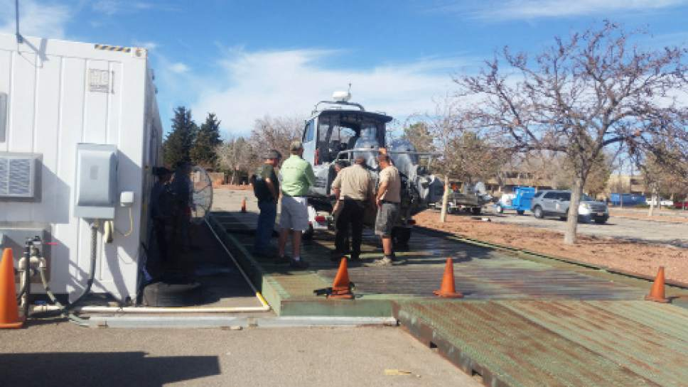 A boat is decontaminated at Lake Powell. Courtesy John Steffan, Utah Division of Wildlife Resources