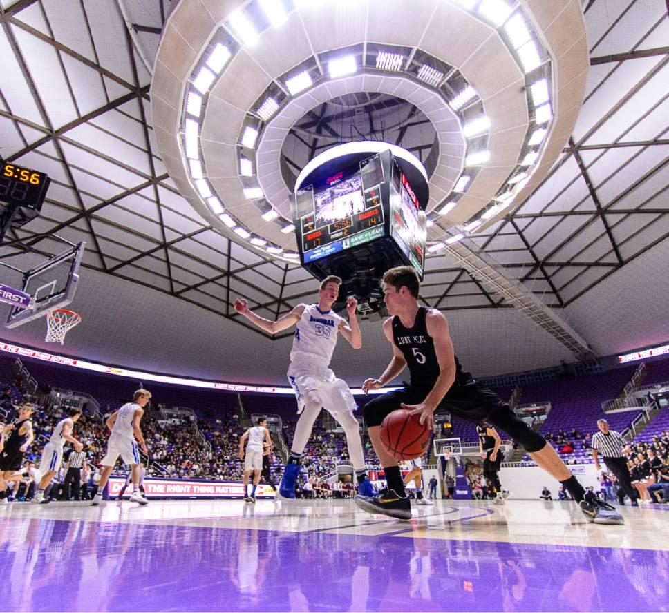 Trent Nelson  |  The Salt Lake Tribune Lone Peak's Max Brenchley (5) drives into Bingham's Branden Carlson (35) as Bingham faces Lone Peak in the 5A state high school basketball championship game, Saturday March 4, 2017.