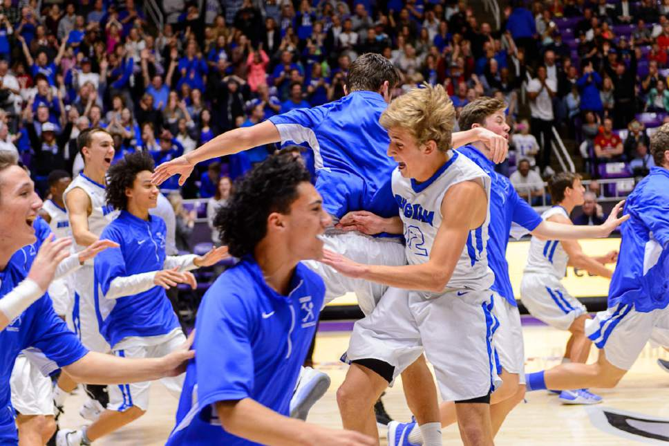 Trent Nelson  |  The Salt Lake Tribune Bingham players celebrate their win over Lone Peak in the 5A state high school basketball championship game, Saturday March 4, 2017.