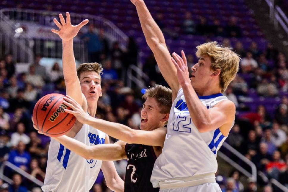 Trent Nelson  |  The Salt Lake Tribune Lone Peak's Garrett Frampton (2) shoots the ball between Bingham's Branden Carlson (35) and Bingham's Preston Fowlks (12), as Bingham faces Lone Peak in the 5A state high school basketball championship game, Saturday March 4, 2017.