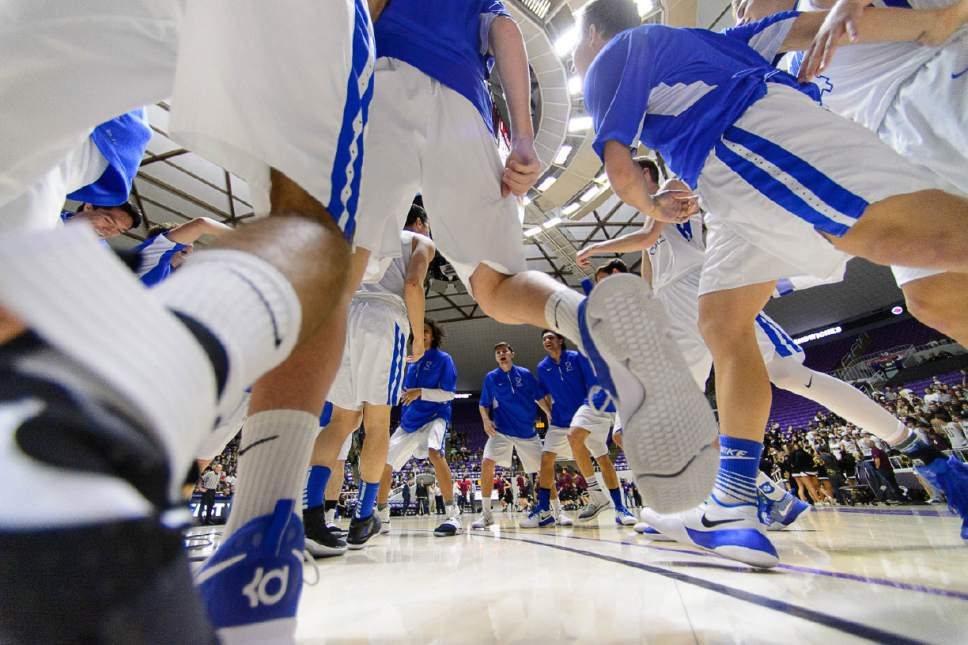 Trent Nelson  |  The Salt Lake Tribune Bingham players huddle pre-game before facing Lone Peak in the 5A state high school basketball championship game, Saturday March 4, 2017.