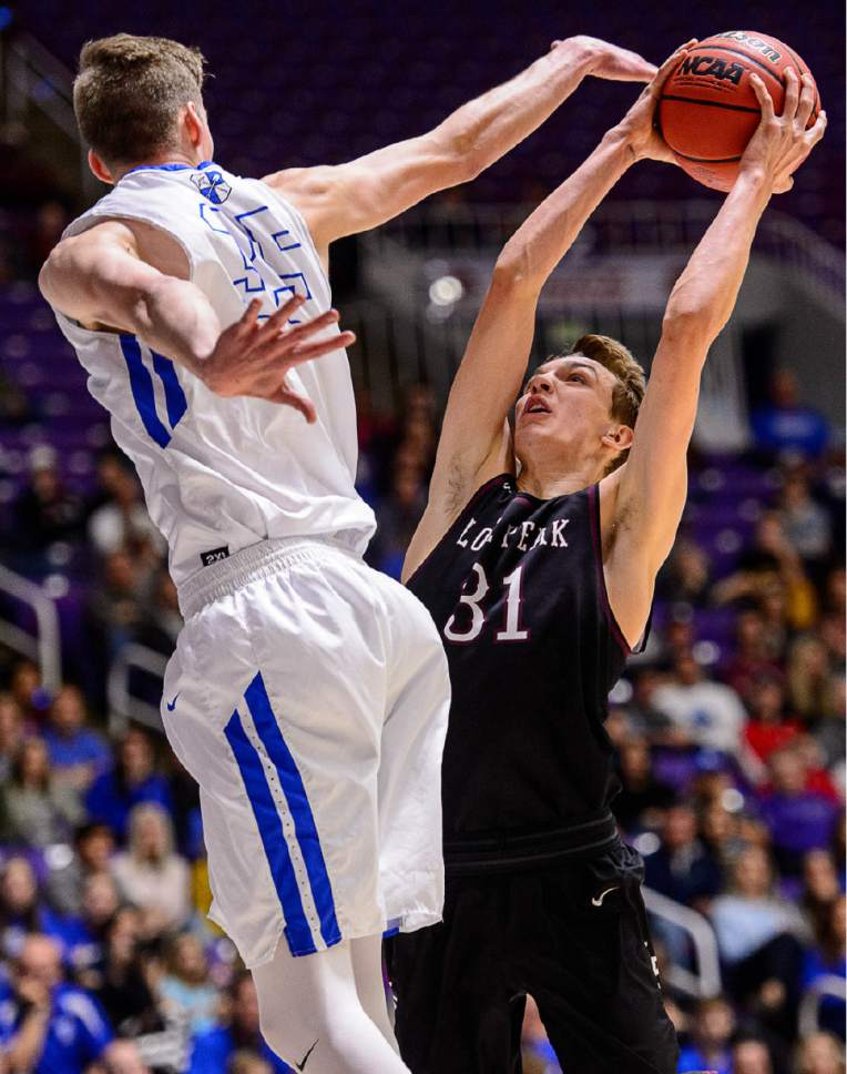 Trent Nelson  |  The Salt Lake Tribune Lone Peak's Maxwell McGrath (31) shoots with Bingham's Branden Carlson (35) defending as Bingham faces Lone Peak in the 5A state high school basketball championship game, Saturday March 4, 2017.