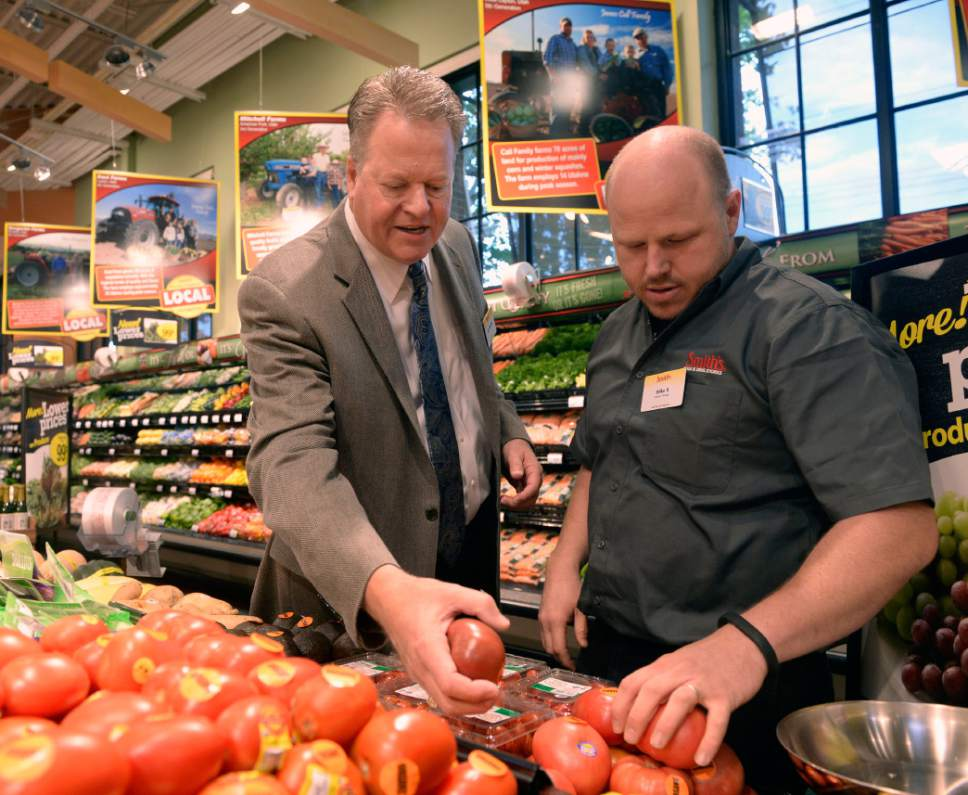 Al Hartmann  |  Tribune file photo Jay Cummins, the president of Smith's Food & Drug, left, checks out selection of heirloom organic tomatos with produce manager Mike Robinson during a tour of the grand re-opening of the store at 900 East and 2700 South Wednesday August 27.