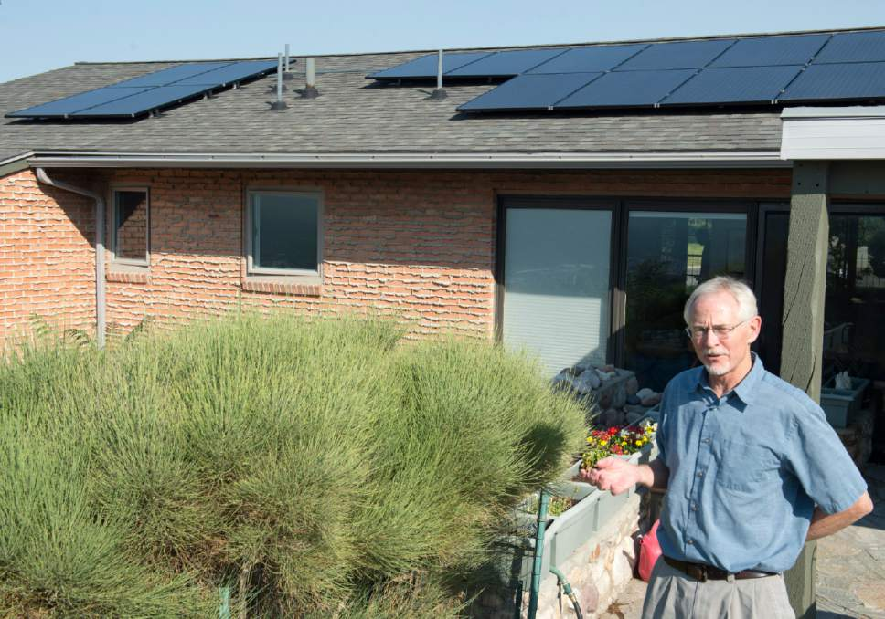 Rick Egan  |  Tribune file photo  Stan Holmes talks about the solar panels he installed on his roof in Salt Lake County in 2014. Critics of a bill moving through the Legislature say it could mean a significant blow to the rooftop solar movement.