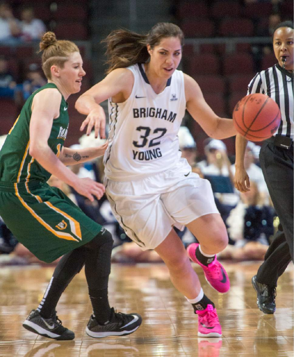 Rick Egan  |  The Salt Lake Tribune  Brigham Young Cougars forward Kalani Purcell (32) is guarded by San Francisco Lady Dons guard Rachel Howard (11), in the West Coast Conference Championship game, at the Orleans Arena in Las Vegas, Tuesday, March 8, 2016.
