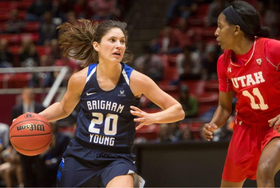 Rick Egan  |  The Salt Lake Tribune  Brigham Young Cougars guard Cassie Broadhead (20) takes the ball inside, as Utah guard Erika Bean (11) defends for the Utes, in Basketball action, Brigham Young Cougars vs. the Utah Utes, Saturday, December 10, 2016.