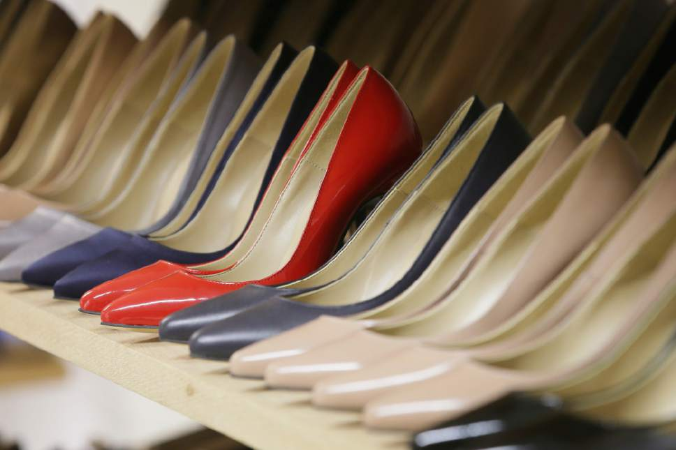 "High heels on display in the Pretty Small Shoes store in Bloomsbury, London, Monday, March 6, 2017. Members of Parliament on Monday will debate banning mandatory workplace high heels, in response to a petition by a receptionist who was sent home for wearing flat shoes. The petition, which calls formal workplace dress codes ""outdated and sexist,"" gathered more than 150,000 signatures, making it eligible for a non-binding debate in Parliament. (AP Photo/Tim Ireland)"