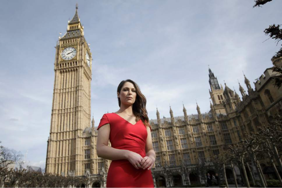 "Equality activist Nicola Thorp poses for a picture outside the Houses of Parliament in London, Monday, March 6, 2017. Nicola Thorp was told in December 2015 that her shoes were unacceptable for a temporary assignment in London with finance firm PwC. Members of Parliament on Monday will debate banning mandatory workplace high heels, in response to a petition by a receptionist who was sent home for wearing flat shoes. Thorp's petition, which calls formal workplace dress codes ""outdated and sexist,"" gathered more than 150,000 signatures, making it eligible for a non-binding debate in Parliament. (AP Photo/Tim Ireland)"