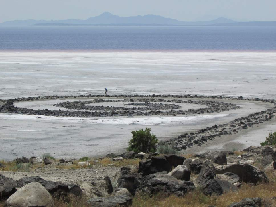Tom Wharton  |  The Salt Lake Tribune   Courtland Nelson walks across the Spiral Jetty in a remote part of Box Elder County.