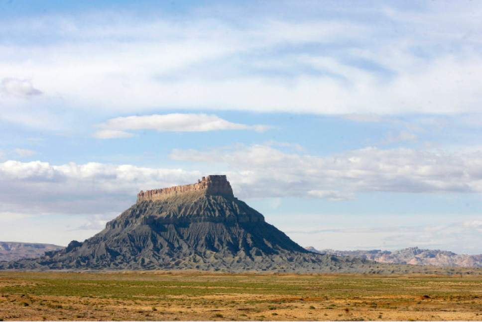 Al Hartmann  |  The Salt Lake Tribune Factory Butte on the southern end of the San Rafael Reef as seen near Hanksville is on the Southern Utah Wilderness Alliance list of Utah's 10 most threatened wilderness treasures.