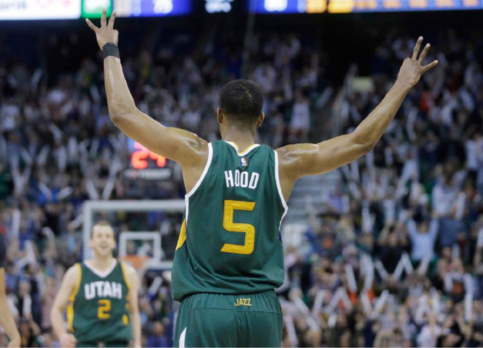 Utah Jazz guard Rodney Hood (5) reacts after Utah Jazz forward Joe Ingles (2) scores a 3-pointer against the New Orleans Pelicans during the second half in an NBA basketball game Monday, March 6, 2017, in Salt Lake City. The Jazz won 88-83. (AP Photo/Rick Bowmer)