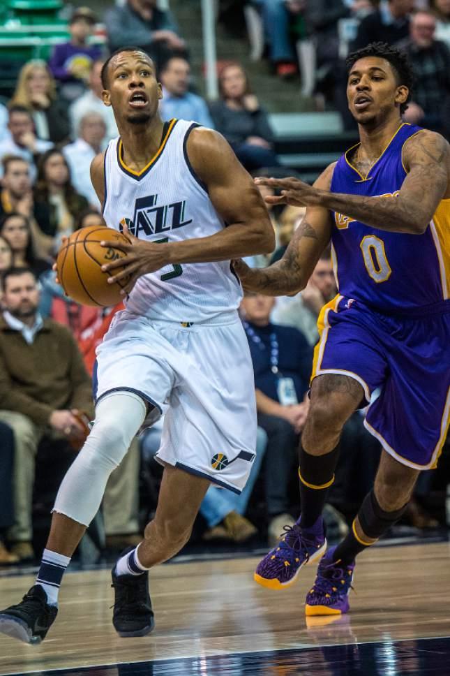 Chris Detrick  |  The Salt Lake Tribune Utah Jazz guard Rodney Hood (5) runs past Los Angeles Lakers guard Nick Young (0) during the game at Vivint Smart Home Arena Thursday January 26, 2017.