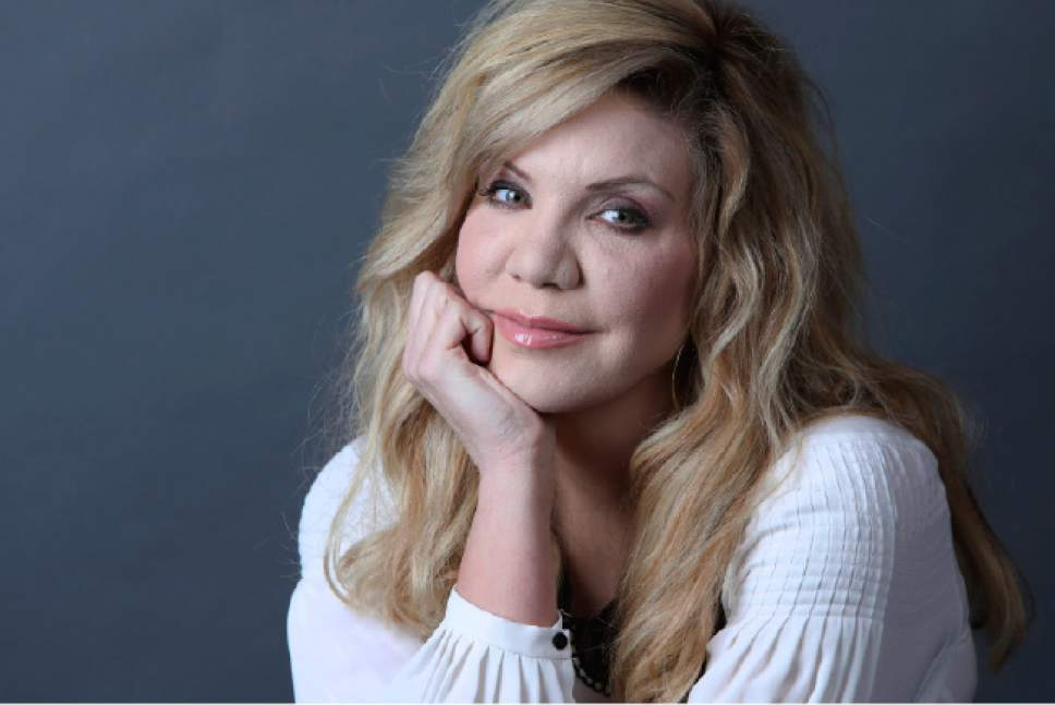 """In this Feb. 23, 2017 photo, Grammy Award-winning artist Alison Krauss poses for a portrait in New York to promote her solo album, """"Windy City."""" (Photo by Amy Sussman/Invision/AP)"""