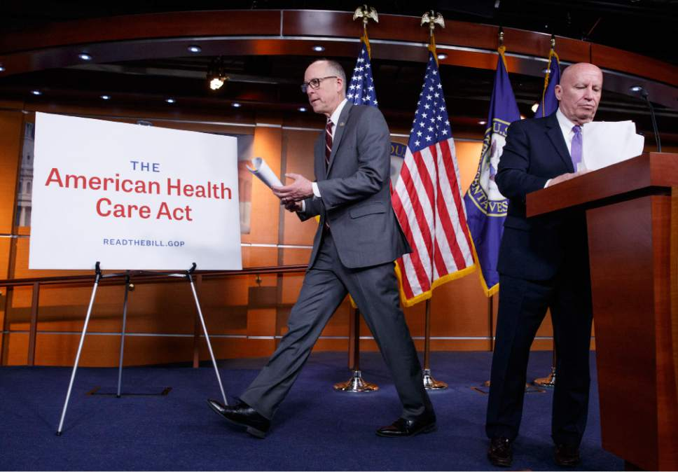 House Ways and Means Committee Chairman Rep. Kevin Brady, R-Texas, right, and House Energy and Commerce Committee Chairman Rep. Greg Walden, R-Ore., wrap up a news conference on Capitol Hill in Washington, Tuesday, March 7, 2017, as House Republicans introduce their plan to repeal and replace the Affordable Care Act.  (AP Photo/J. Scott Applewhite)