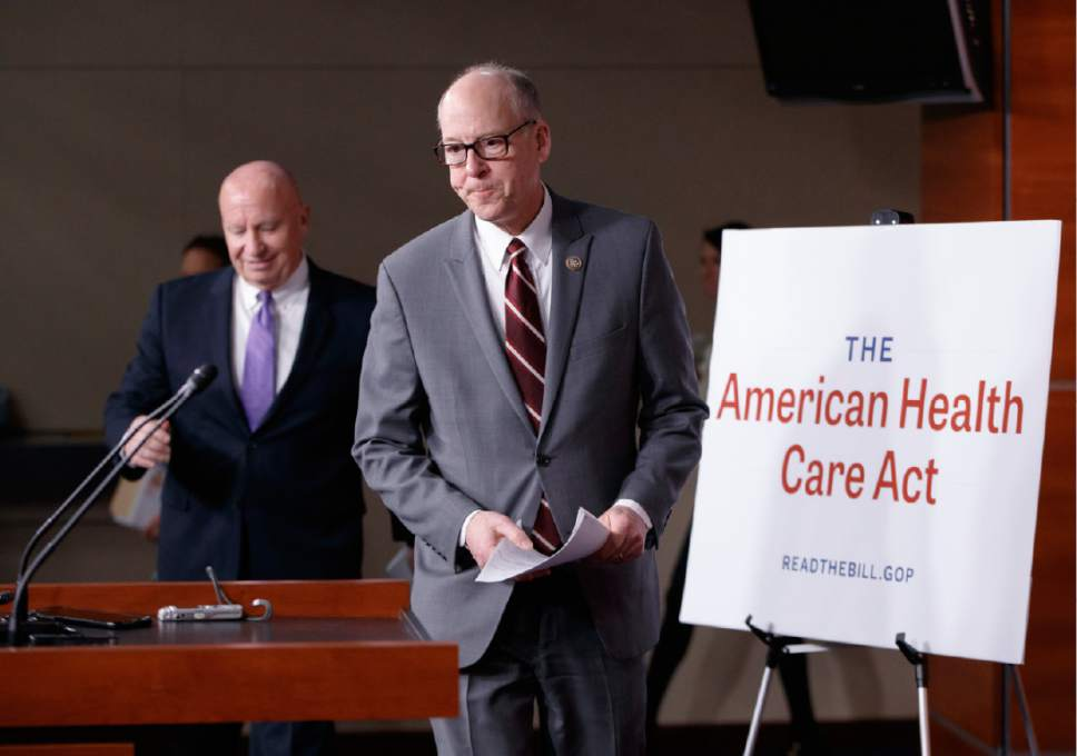 House Ways and Means Committee Chairman Rep, Kevin Brady, R-Texas, left, follows House Energy and Commerce Committee Chairman Rep. Greg Walden, R-Ore. to a news conference on Capitol Hill in Washington, Tuesday, March 7, 2017,  as House Republicans introduce their plan to repeal and replace the Affordable Care Act.  (AP Photo/J. Scott Applewhite)