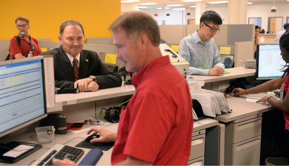 Al Hartmann  |  Tribune file photo Utah Gov. Gary Herbert receives his temporary driver license at the Fairpark Driver License office in Salt Lake City on Monday, July 1, 2016.