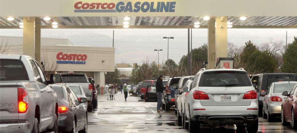 Al Hartmann  |  The Salt Lake Tribune Drivers line up for gas at Costco at 1800 S. 300 West in Salt Lake City Monday Dec. 22, 2014. Gasoline is under $2 a gallon in some places in the Salt Lake area, mostly at Costco and Sam's Club.