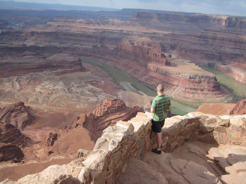 Tribune file photo  A tourist enjoys the view from Dead Horse Point State Park near Moab.