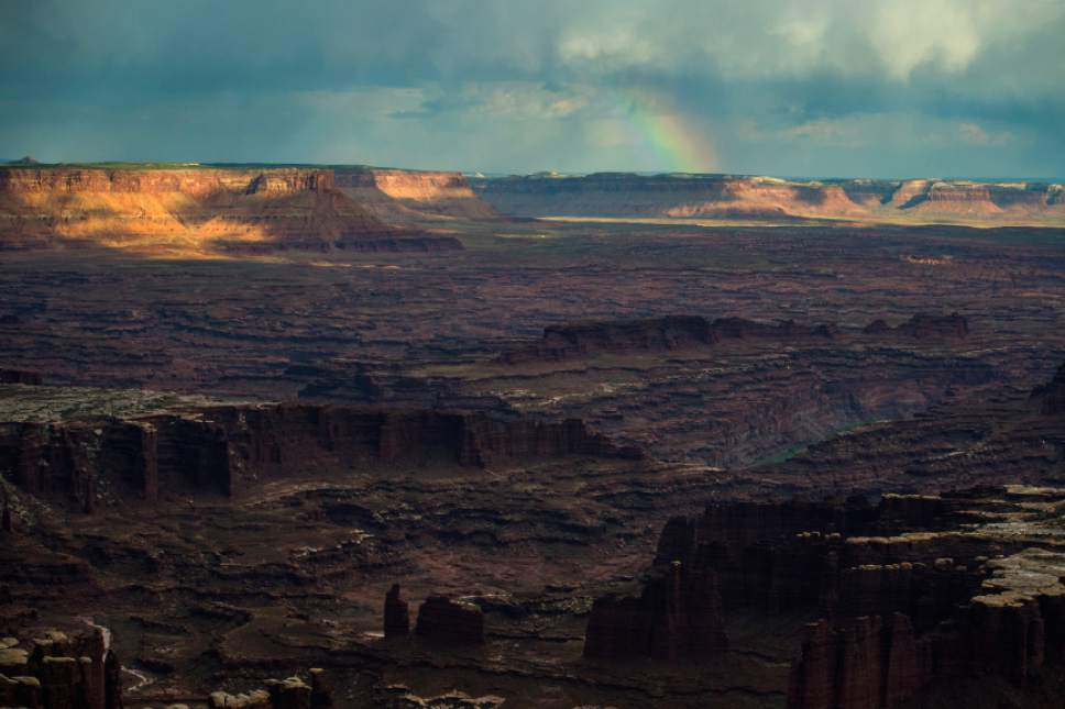Chris Detrick  |  The Salt Lake Tribune A rainbow appears in the distance as seen from Grand View Point in the Island in the Sky District at Canyonlands National Park.