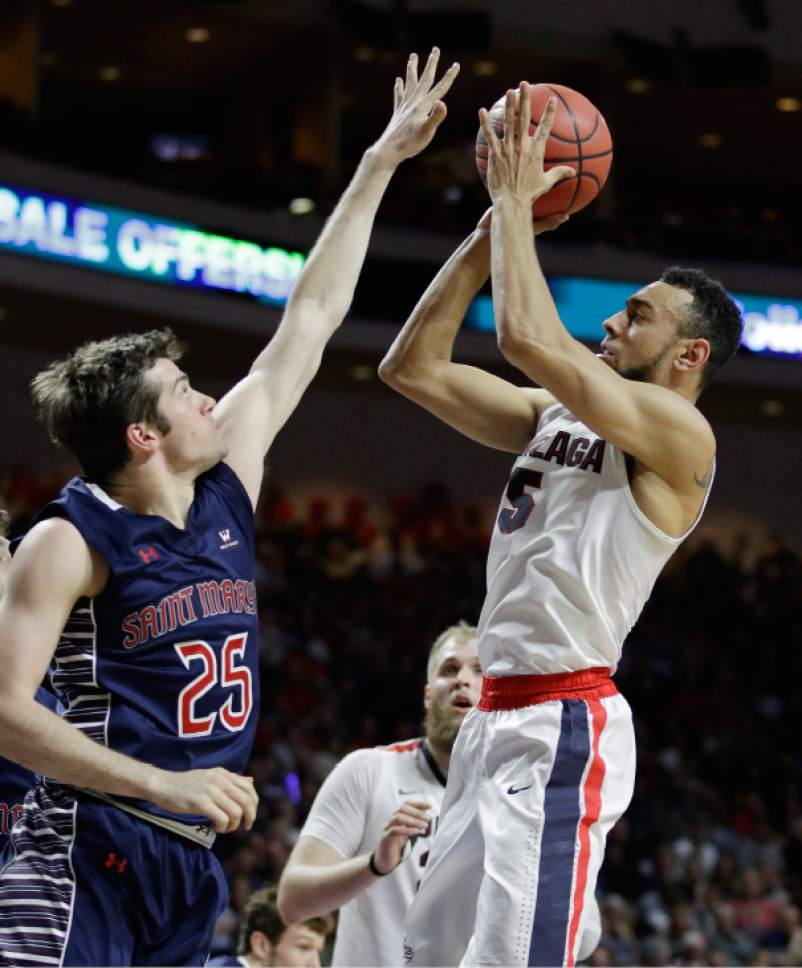 Gonzaga's Nigel Williams-Goss shoots over Saint Mary's Joe Rahon in the first half of an NCAA college basketball game during the championship of the West Coast Conference tournament, Tuesday, March 7, 2017, in Las Vegas. (AP Photo/John Locher)