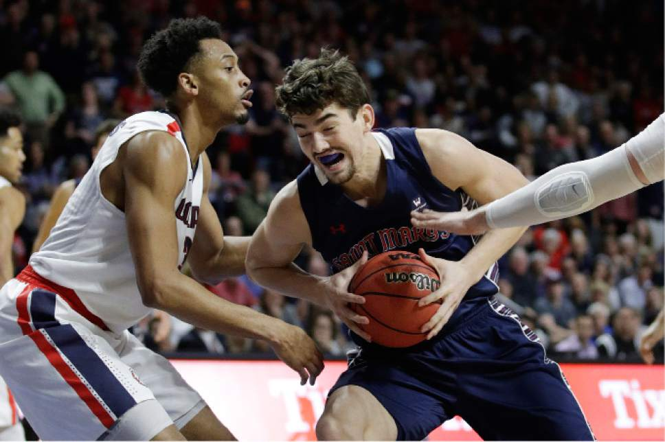 Saint Mary's Jordan Hunter drives into Gonzaga's Johnathan Williams in the second half of an NCAA college basketball game during the championship of the West Coast Conference tournament, Tuesday, March 7, 2017, in Las Vegas. Gonzaga won 74-56. (AP Photo/John Locher)
