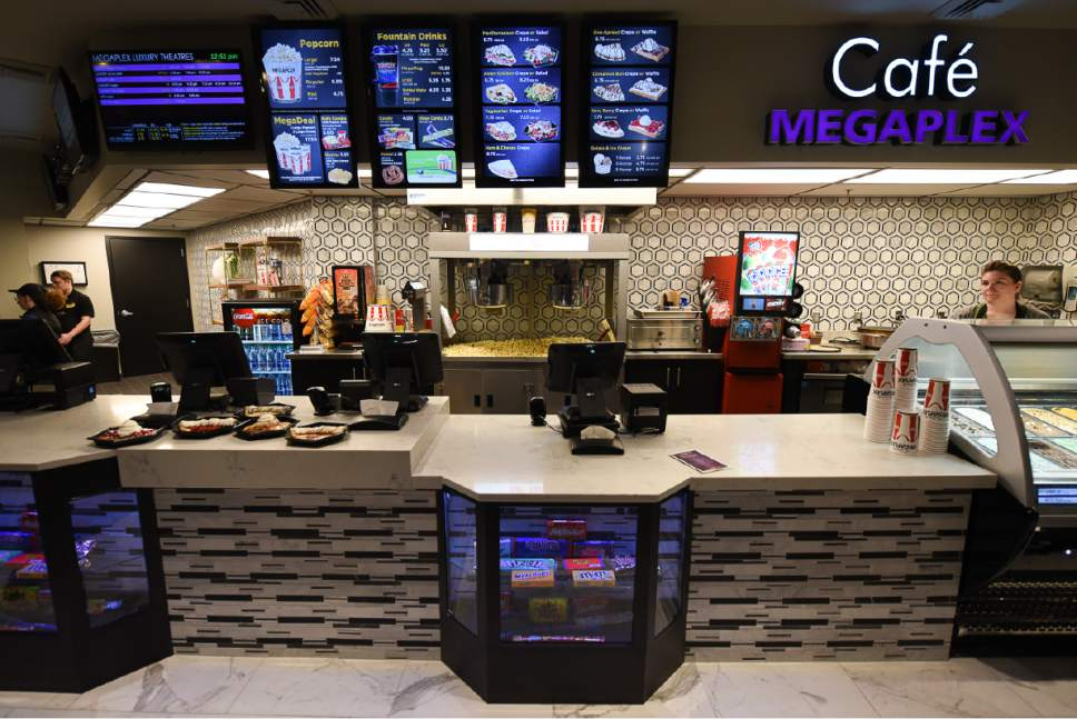 Francisco Kjolseth | The Salt Lake Tribune Megaplex Luxury Theatres at Cottonwood, 1945 E. Murray Holladay Road, opens with a fresh remodel that includes, updated concessions, remodeled bathrooms and reclining heated seats.