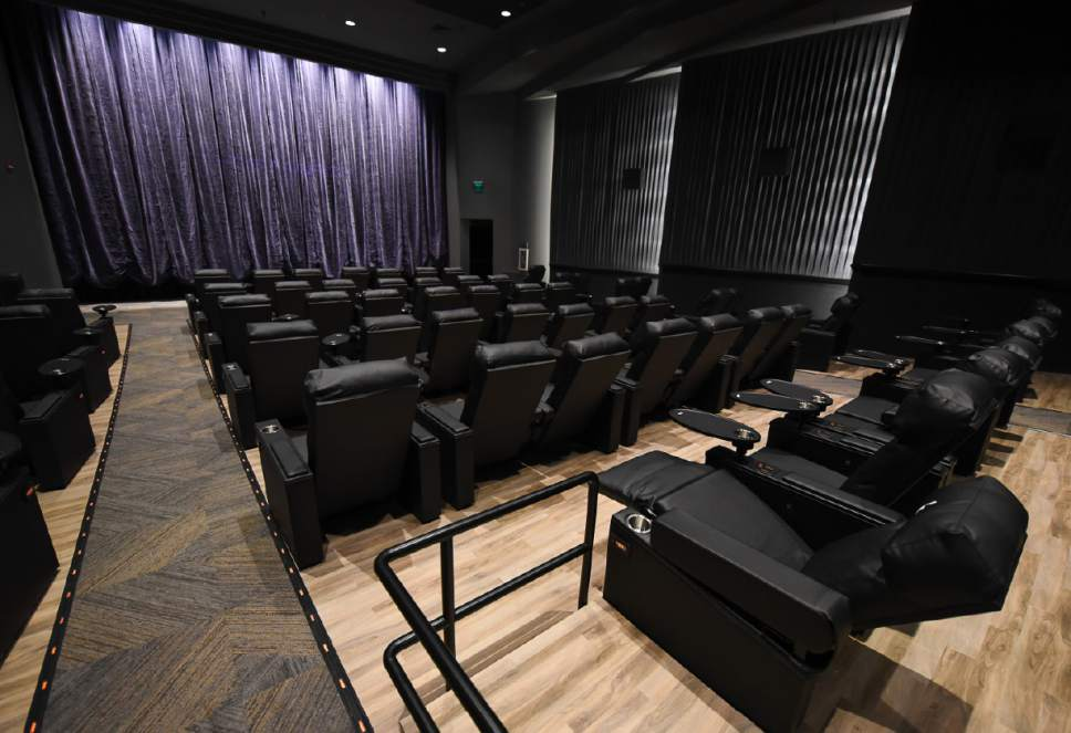 Francisco Kjolseth | The Salt Lake Tribune Megaplex Luxury Theatres at Cottonwood, 1945 E. Murray Holladay Road, opens  with a fresh remodel that includes reclining heated seats and a swiveling table on each chair.
