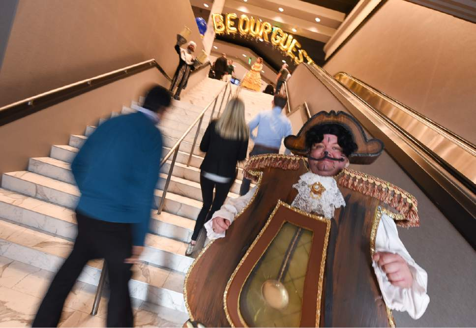 "Francisco Kjolseth | The Salt Lake Tribune Dan Call brings Cogsworth the clock from"" Beauty and the Beast"" to life as part of the grand opening of the Megaplex Luxury Theatres at Cottonwood, 1945 E. Murray Holladay Road."