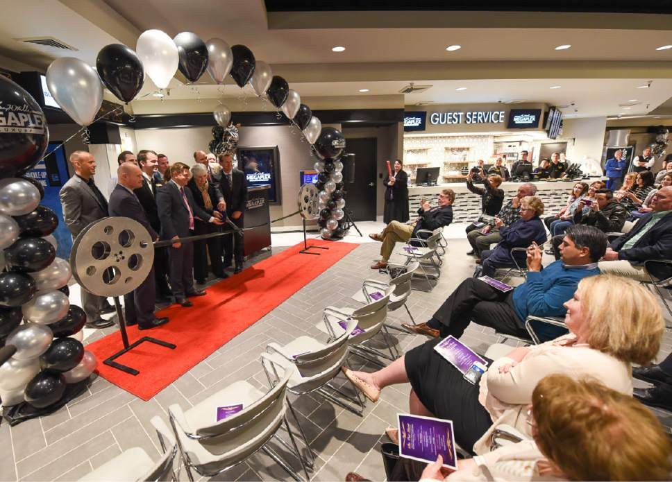 "Francisco Kjolseth | The Salt Lake Tribune Gail Miller, founder and owner, Larry H. Miller Group, center, is joined for the ceremonial ""film"" cutting of the new Megaplex Luxury Theatres at Cottonwood, 1945 E. Murray Holladay Road, on Wednesday, March 8, 2017."