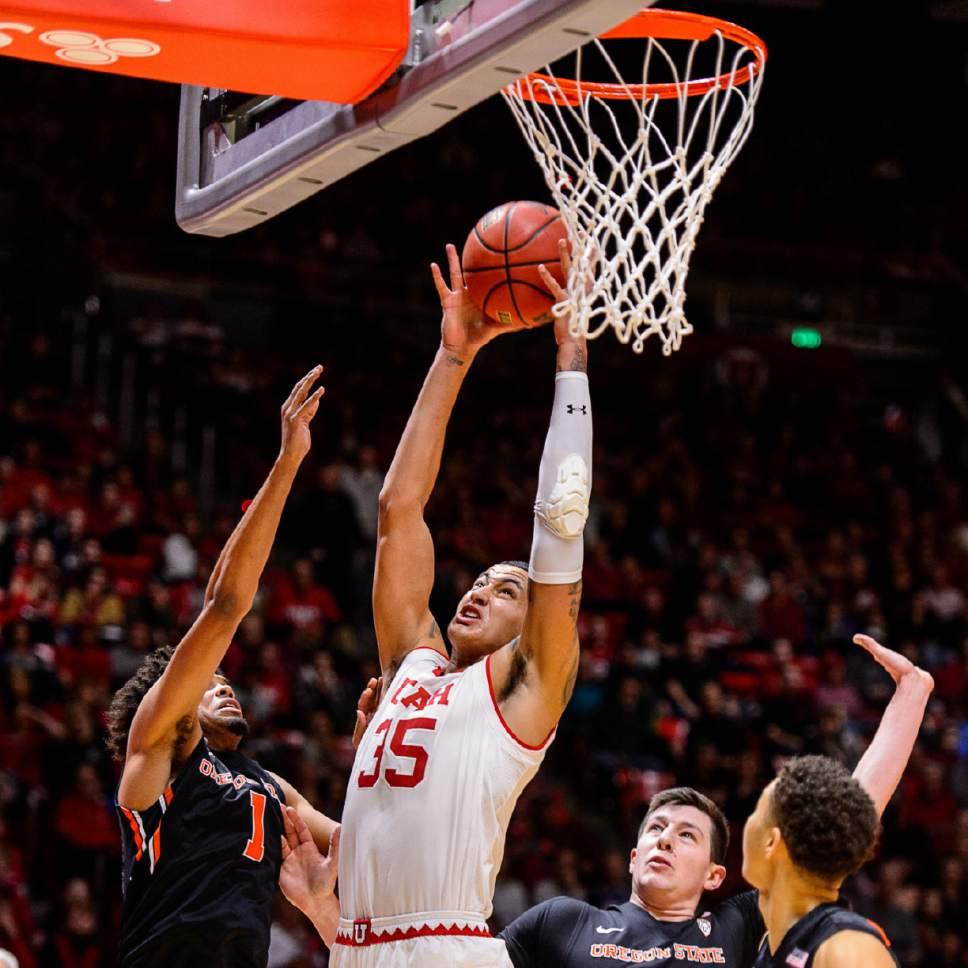 Trent Nelson  |  The Salt Lake Tribune Utah Utes forward Kyle Kuzma (35) pulls down a rebound as the University of Utah hosts Oregon State, NCAA basketball at the Huntsman Center in Salt Lake City, Saturday January 28, 2017.