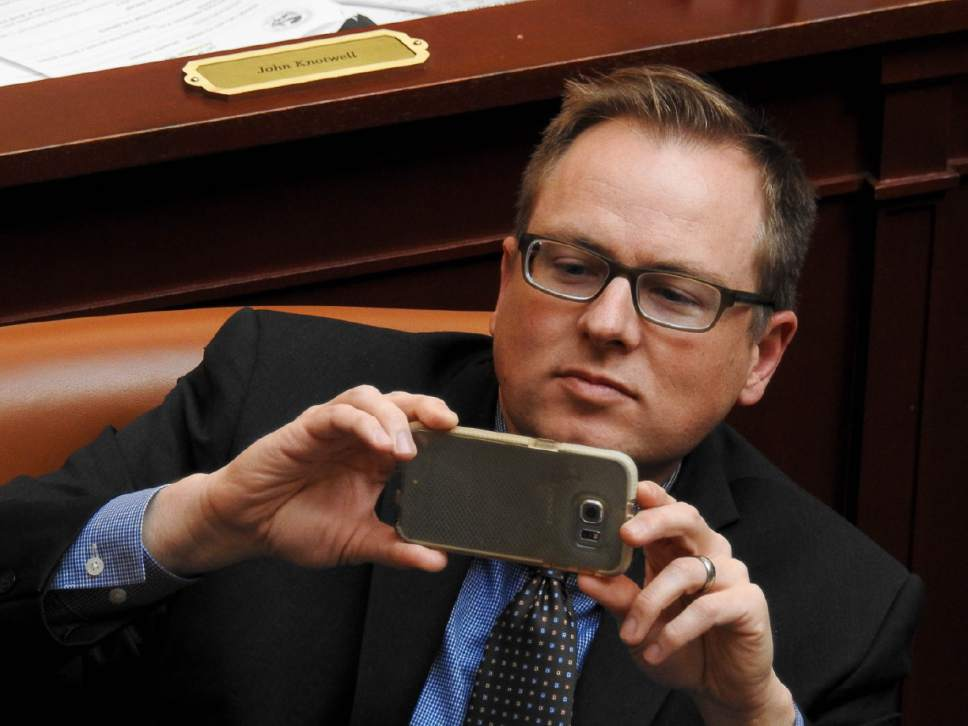 Trent Nelson  |  The Salt Lake Tribune Rep. Jeremy Peterson, R-Ogden, takes a photo as the Utah House debates and passes SB159, which requires motorcyclists under 21 to wear a helmet, Wednesday March 8, 2017 in Salt Lake City.