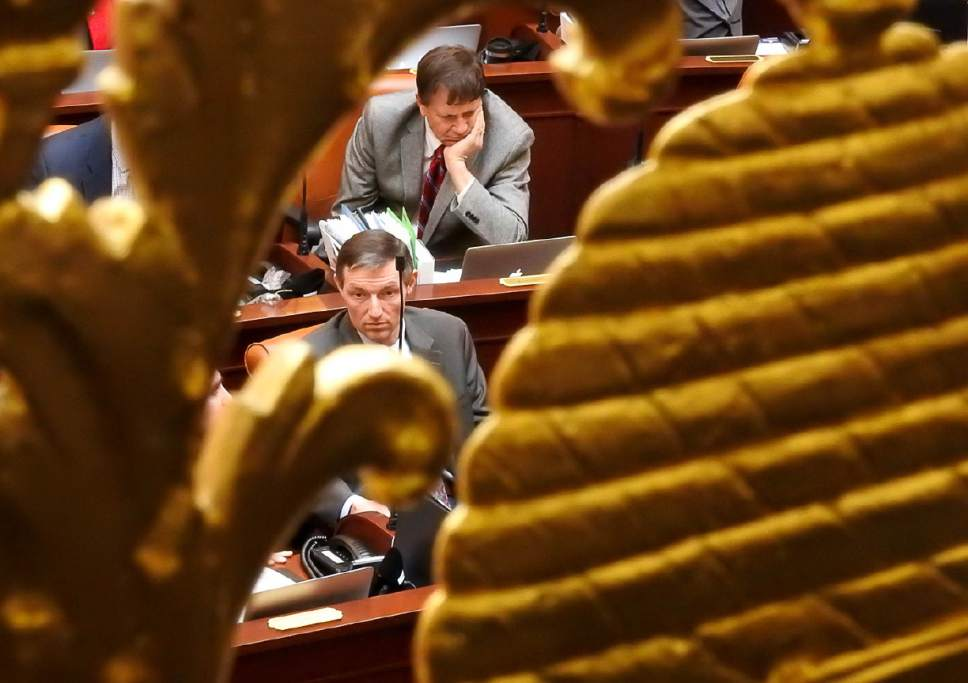Trent Nelson  |  The Salt Lake Tribune Legislators listen as the Utah House debates and passes SB159, which requires motorcyclists under 21 to wear a helmet, Wednesday March 8, 2017 in Salt Lake City.