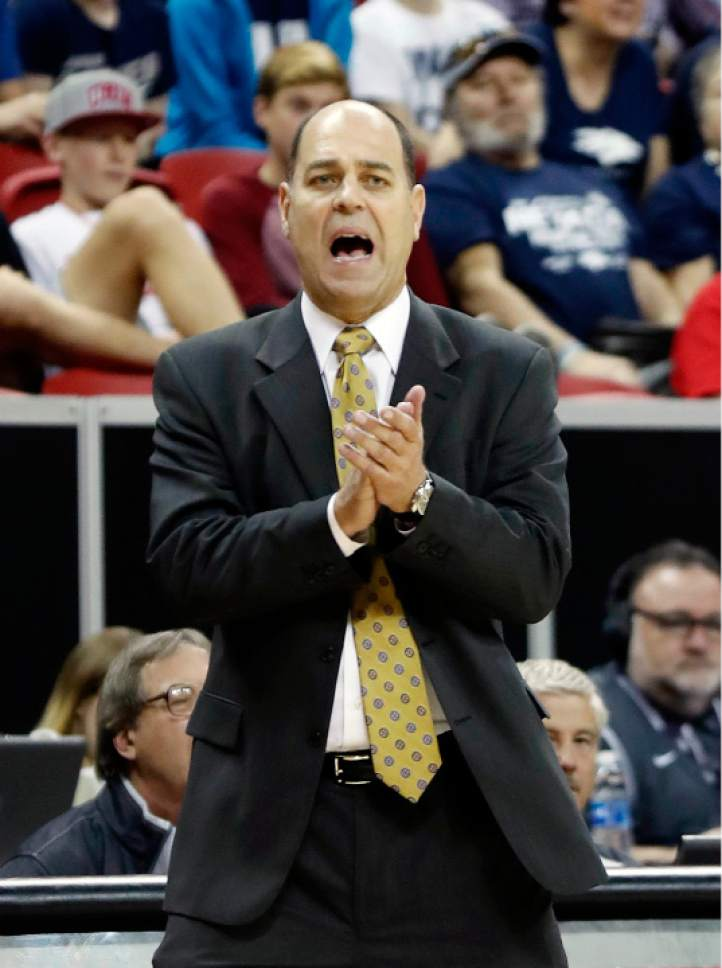 Utah State head coach Tim Duryea instructs his team during the second half of an NCAA college basketball game against Nevada in the Mountain West Conference tournament Thursday, March 9, 2017, in Las Vegas. Nevada defeated Utah State 83-69. (AP Photo/Isaac Brekken)