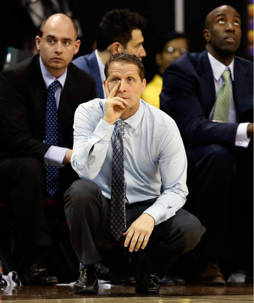 Nevada head coach Eric Musselman watches his team play during the first half of an NCAA college basketball game against Nevada in the Mountain West Conference tournament Thursday, March 9, 2017, in Las Vegas. (AP Photo/Isaac Brekken)