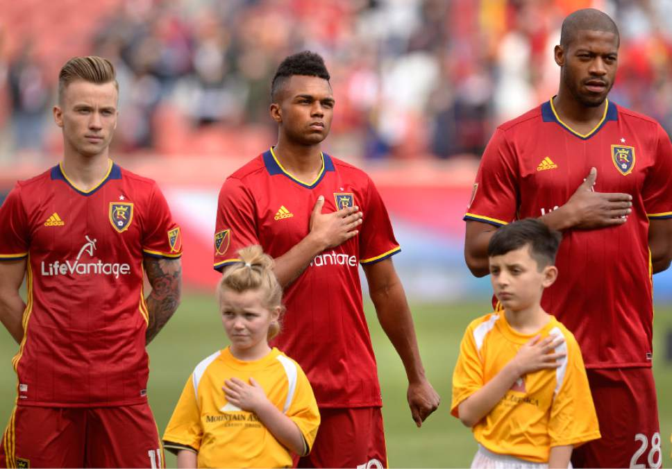 "Leah Hogsten | The Salt Lake Tribune ""I don't personally feel that acknowledging issues within the country and being a proud American are mutually exclusive,"" said Real Salt Lake midfielder Jordan Allen, center, who places his right hand over his heart and fists his left hand, holding it out to the side during the national anthem."