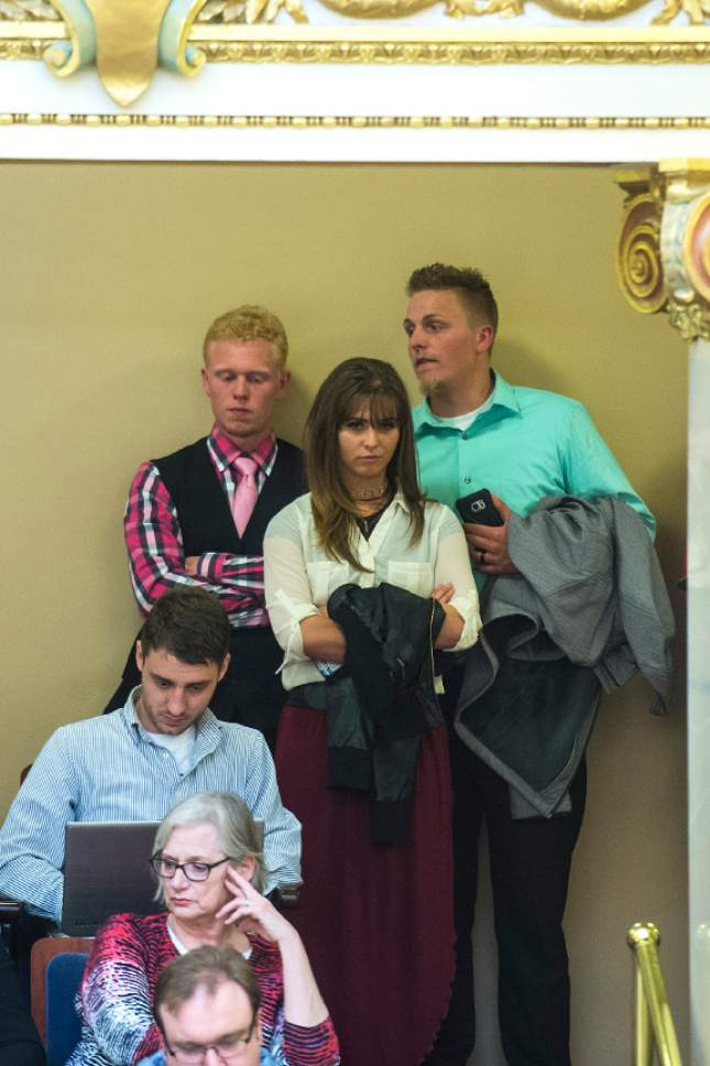 Chris Detrick     The Salt Lake Tribune Kyler Henderson, Kayla Henderson and Lance Henderson  listen during Senate Floor Time at the Utah State Capitol Thursday March 9, 2017.