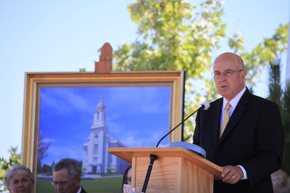 Courtesy | Intellectual Reserve, Inc.  Elder L. Whitney Clayton, member of the Presidency of the Seventy of The Church Jesus Christ of Latter-day Saints, speaks before a crowd of Mormon faithful at the groundbreaking of the Cedar City Utah Temple.