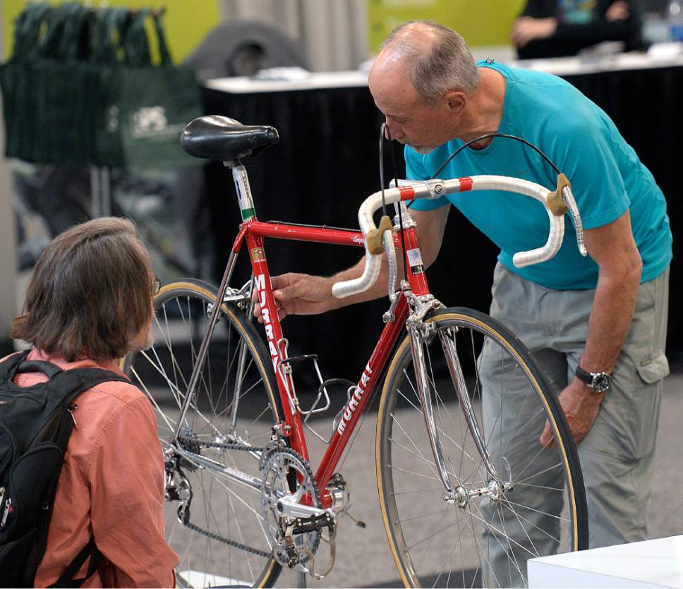 Al Hartmann  |  The Salt Lake Tribune Bike enthusiasts look at the details of a 1984 Davis Phinney's Olympic Serotta from The Pro's Closet Bicycle Museum at the 2017 North American Handmade Bicycle Show at the Salt Palace Convention Center Friday March 10. It's the largest and oldest handbuilt bicycle show in the world where ideas and innovation come together to promote custom bicycles and the companies that support the market.  It's the show's first time in Utah. The event runs Friday, March 10, to Sunday, March 12.