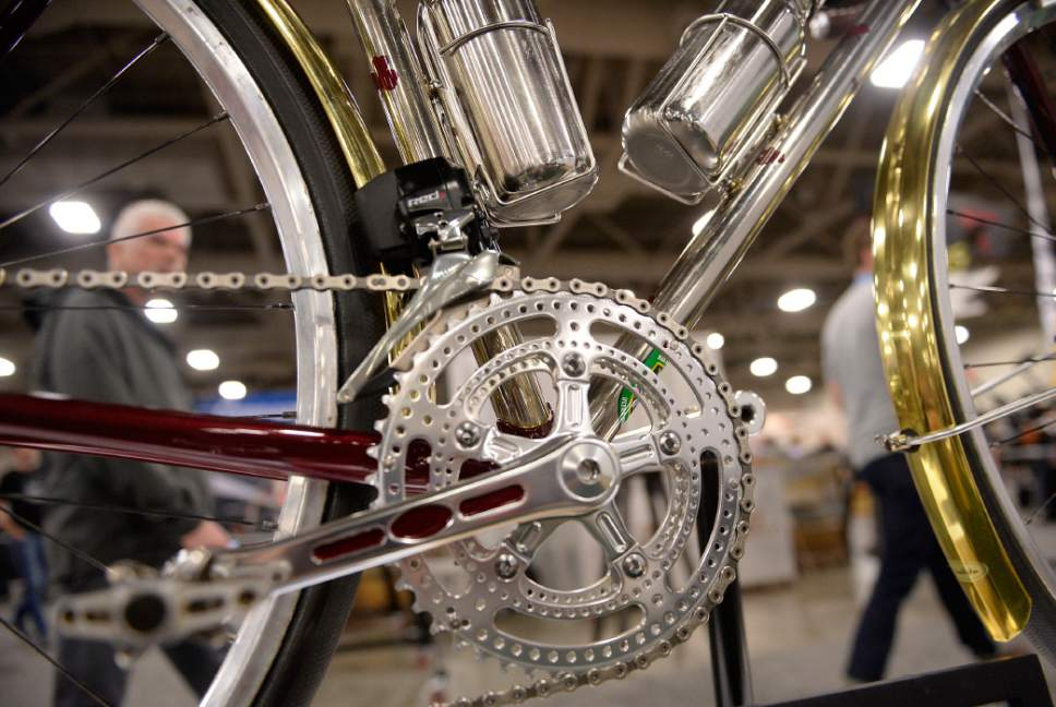 Al Hartmann  |  The Salt Lake Tribune Detail work on a handmade Shamrock bicycle at the 2017 North American Handmade Bicycle Show at the Salt Palace Convention Center Friday March 10.  Shamrock Cycles are made in Indiana.   They have an old world feel using polished lugs and tubes, single color paint and leather parts.  It's the largest and oldest handbuilt bicycle show in the world where ideas and innovation come together to promote custom bicycles and the companies that support the market.  It's the show's first time in Utah. The event runs Friday, March 10, to Sunday, March 12.