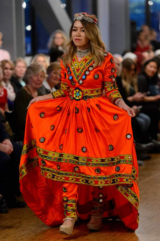 Trent Nelson     The Salt Lake Tribune Models parade dresses from around the world during a fashion show fundraiser for Women of the World at The Leonardo in Salt Lake City, Thursday March 9, 2017.