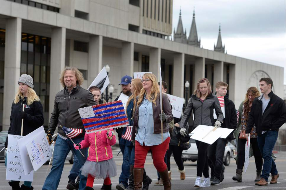 Scott Sommerdorf   |  The Salt Lake Tribune   Polygamist Kody Brown and his family marched across State Street near the LDS Office Building in order to meet up with other polygamists and supporters prior to marching to the Capitol where they held a rally, Friday, Feb. 10, 2017.
