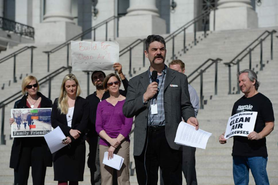 "Francisco Kjolseth | The Salt Lake Tribune Matt Pacenza, front, Executive Director of HEAL Utah and members of Breathe Utah, ""stand for clear air"" as part of a rally at the Utah Capitol on Tuesday, Feb. 16, 2016, to push for more energy efficient and green building codes."