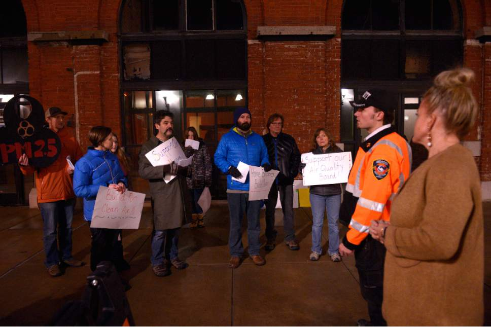 "Leah Hogsten  |  The Salt Lake Tribune Clean air activist Matt Pacenza, Executive Director of HEAL Utah is told by a Trolley Square security and a Falls Event Center employee to take their peaceful rally to the sidewalks away from the Utah Home Builders' Association annual gala – ""Denim & Diamonds Awards Gala,"" Friday, January 15, 2016. The rally was to urge one of state's most powerful sectors to embrace commonsense public policies to clean up the Wasatch Front's dirty air."