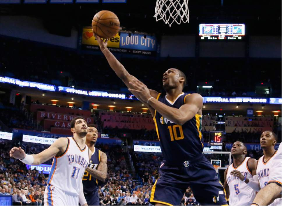 Utah Jazz guard Alec Burks (10) shoots in front of Oklahoma City Thunder center Enes Kanter (11) in the third quarter of an NBA basketball game in Oklahoma City, Saturday, March 11, 2017. Oklahoma City won 112-104. (AP Photo/Sue Ogrocki)