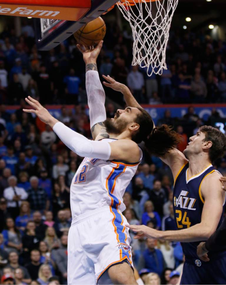Oklahoma City Thunder center Steven Adams (12) shoots in front of Utah Jazz center Jeff Withey (24) in the first quarter of an NBA basketball game in Oklahoma City, Saturday, March 11, 2017. (AP Photo/Sue Ogrocki)