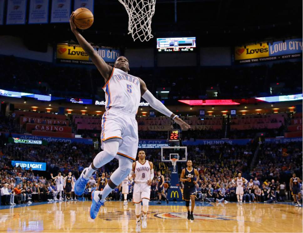 Oklahoma City Thunder guard Victor Oladipo (5) goes up for a dunk in the second quarter of an NBA basketball game against the Utah Jazz in Oklahoma City, Saturday, March 11, 2017. Oklahoma City won 112-104. (AP Photo/Sue Ogrocki)