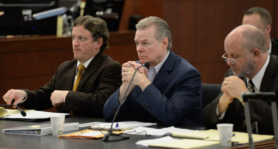 Francisco Kjolseth  |  The Salt Lake Tribune  A new murder trial begins for Douglas Anderson Lovell, 57, center, charged with aggravated murder for allegedly kidnapping and killing 39-year-old Joyce Yost in 1985 to keep her from testifying against him in a rape case. Lovell who appeared in 2nd District Court, in Ogden on Monday, March, 16, 2015, is seen facing into the courtroom gallery where the jury was being selected for his trial.