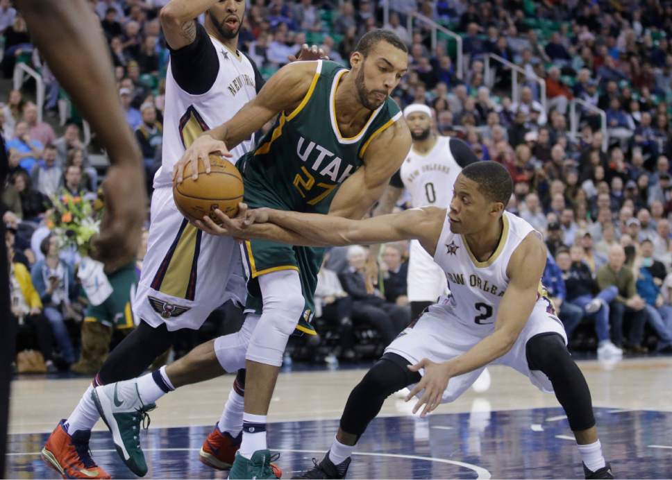 New Orleans Pelicans guard Tim Frazier (2) guards Utah Jazz center Rudy Gobert (27) during the second half in an NBA basketball game, Monday, March 6, 2017, in Salt Lake City. The Jazz won 88-83. (AP Photo/Rick Bowmer)